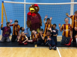 The junior team after the shoot out with Billy Bantam the Bradford City Football team mascot