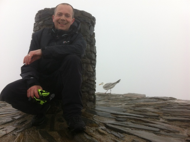 Andrew Caple with 'friend 'at the top of Snowdon