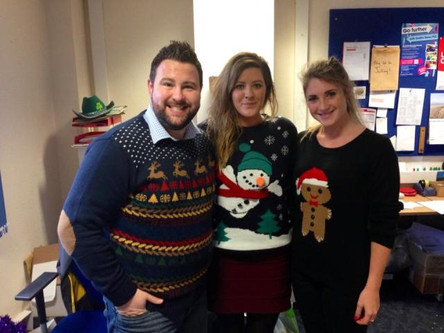 Instore show off their festive jumpers