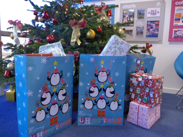 Christmas presents by the tree ready to take to the refuge
