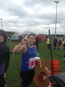 Bungay marathon runner with her finishers medal