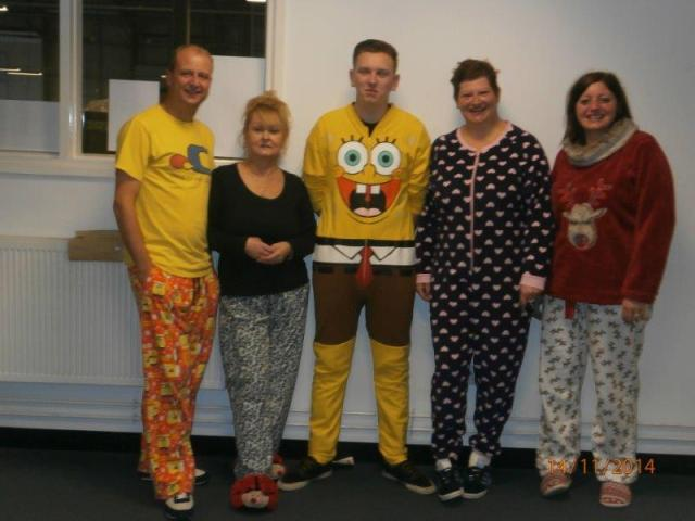 Newport staff bring out their onesies for Children in Need