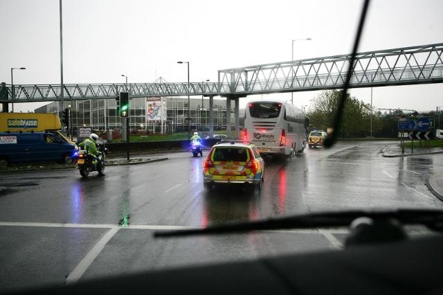 Under police escort